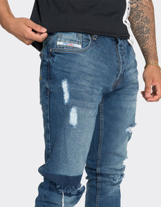 Blue slim fit knee patch jeans
