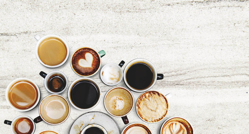 Image shows a selection of coffee cups containing various different coffees such as cappuccino, flat white, latte, americano, espresso, cortado, macchiato and latte art , ,