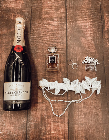 Champagne bridal flat lay with garter