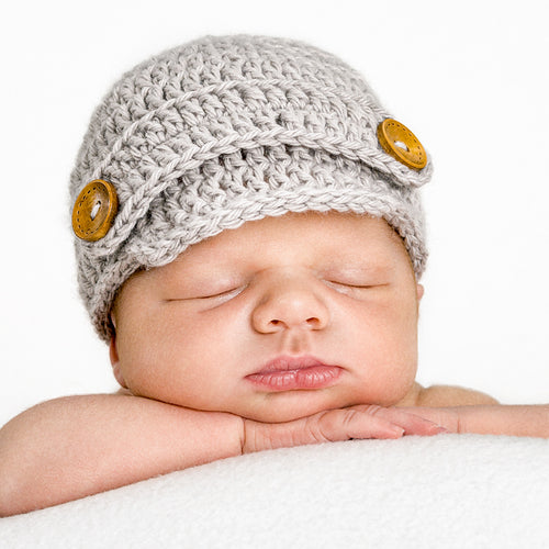 Gray newsboy hand-knitted newborn baby hat with wooden buttons