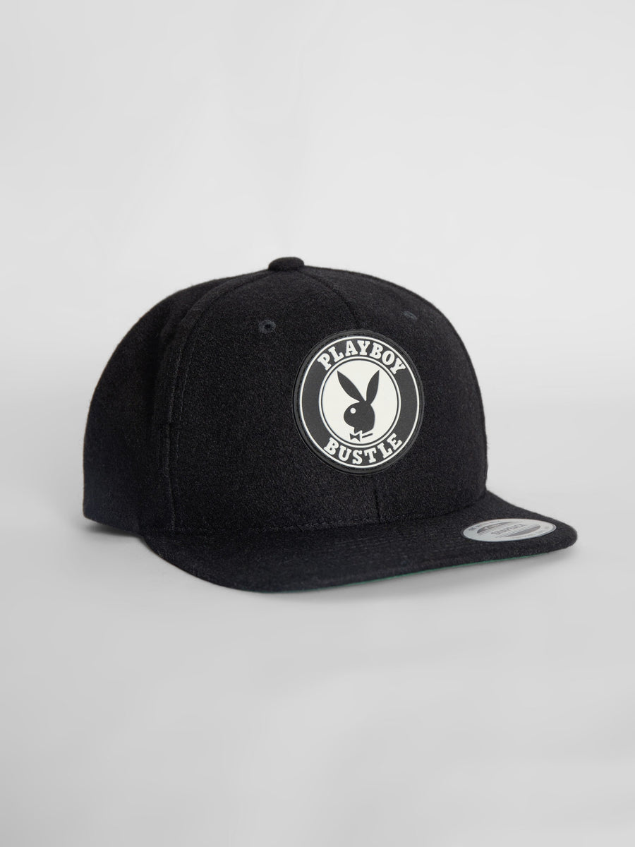 Snap-back cap in black wool - bustleclothing.shop