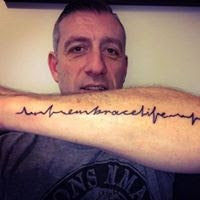 man with a f cancer tattoo on forearm