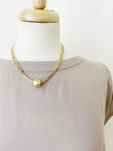 Brushed Gold Sphere Multi Chain Necklace