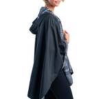 Load image into Gallery viewer, Reversible Travel Cape in Black & White Houndstooth Plaid