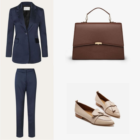 Blue suit for women with a brown business bag