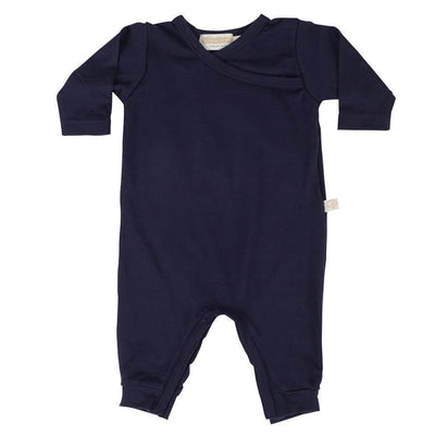 mokopuna all in one romper in merino with long legs with domes, long sleeves and wrap neckline in size 0_marine