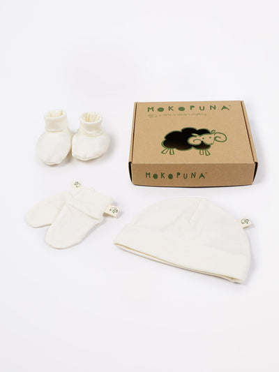 mokopuna set of merino newborn essentials, beanie, booties, scratch mittens, packed in a gift box in size NB_lily