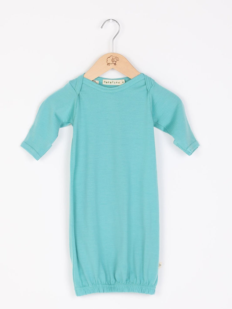 mokopuna sleepsuit gown in merino with envelope neckline, built-in mitts and elastic bottom in size NB_tealeaf