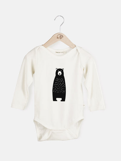 mokopuna long sleeve bodysuit in merino with envelope neckline in size NB_lily bear