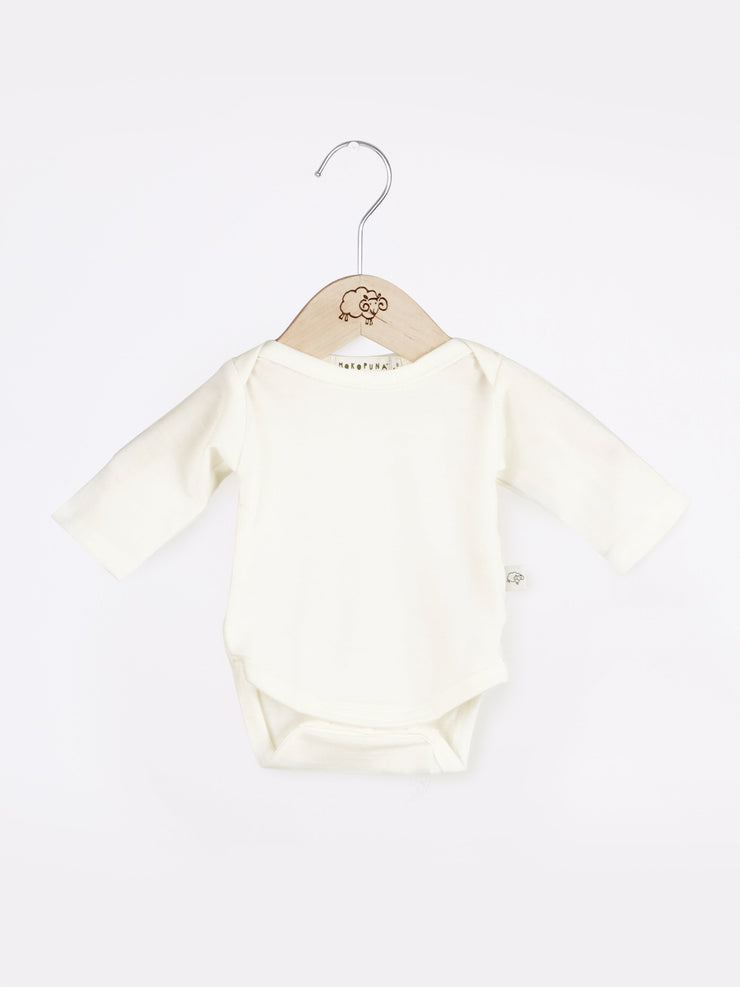 mokopuna long sleeve bodysuit in merino with envelope neckline in size PREM_lily