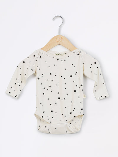 mokopuna long sleeve bodysuit in merino with envelope neckline in size NB_stardust