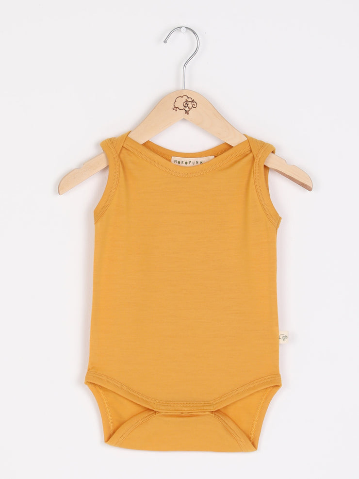 mokopuna merino singlet bodysuit sleeveless, envelope neckline in size NB_butterscotch