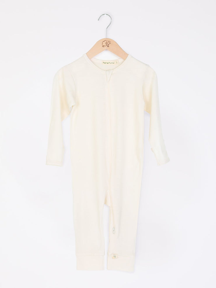 mokopuna all in one romper in merino with long legs, a two-way zip, long sleeves and round neckline in size NB_lily