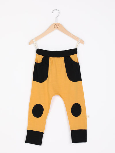 mokopuna slouch trackpants in merino, with elastic waistband, pockets and knee pads in size 4_butterscotch