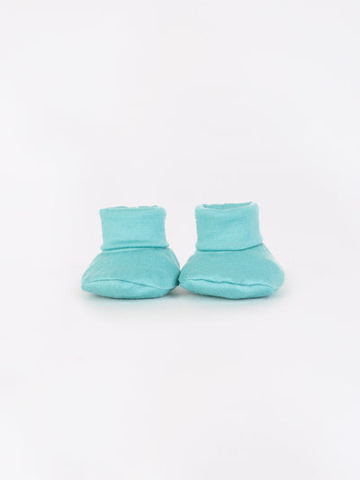 mokopuna newborn booties in merino with foldable cuffs in size NB_tealeaf