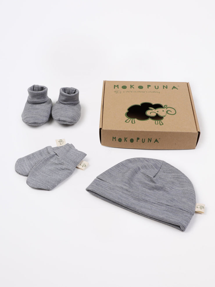 mokopuna set of merino newborn essentials, beanie, booties, scratch mittens, packed in a gift box in size NB_mist