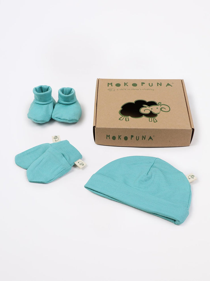 mokopuna set of merino newborn essentials, beanie, booties, scratch mittens, packed in a gift box in size NB_tealeaf