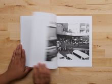 Load image into Gallery viewer, Crossing Strangers by Andile Buka