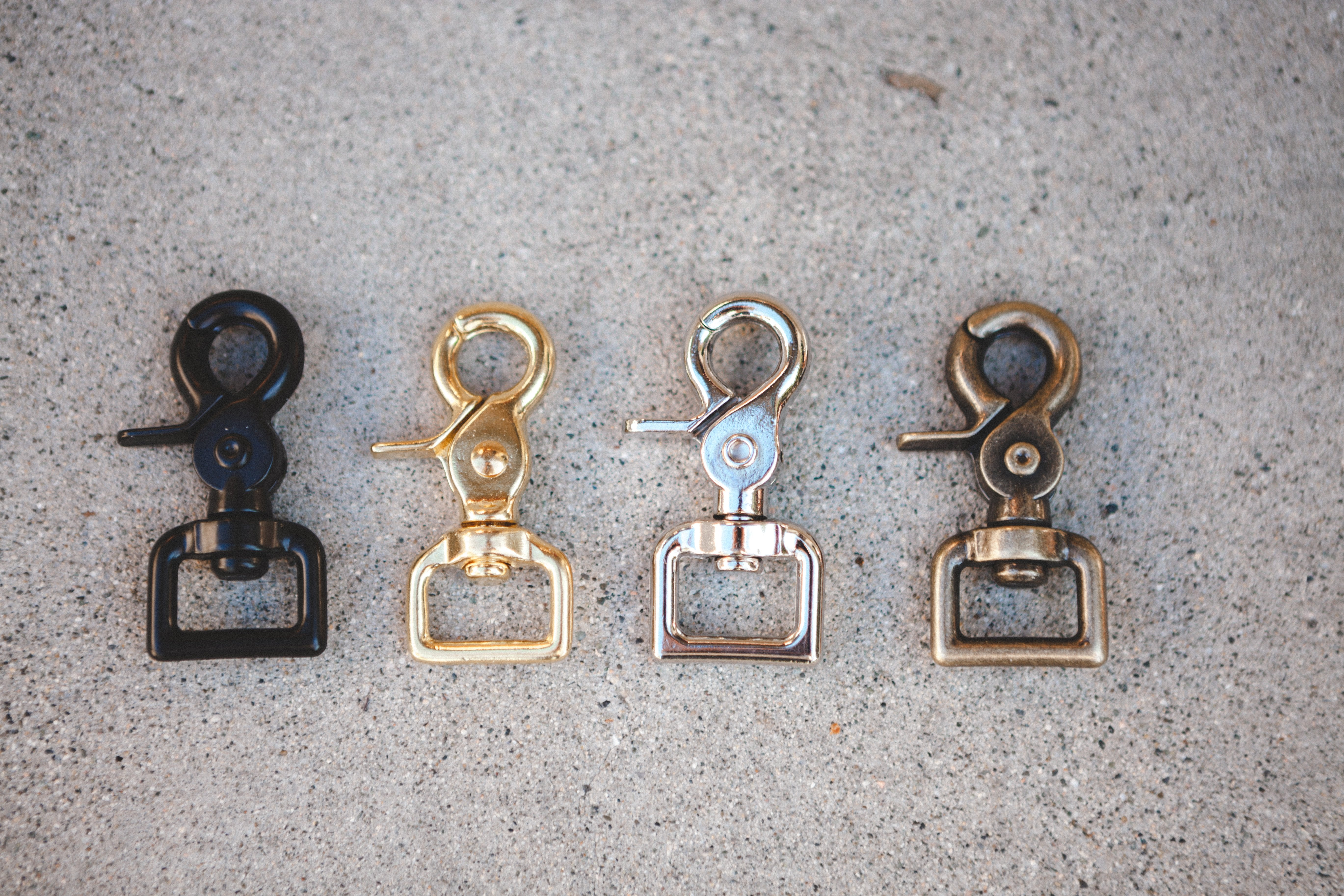 brass hardware in black, brass, silver, and antique brass
