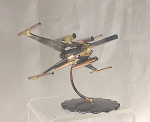 Recycled metal X-Wing figure