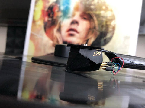 "Close-up of a 2M Black playing a copy of Beck's album ""Morning Phase"""