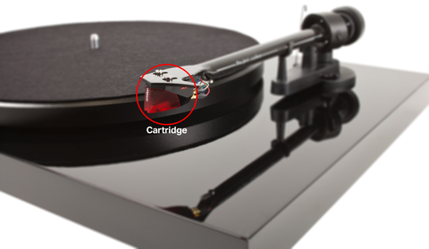 A close-up of the cartridge on a turntable