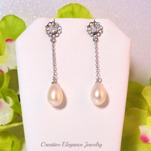 White Fresh Water Pearl, Long Drop Earrings, set in 92.5 Sterling Silver