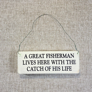 Signs-small-A-great-fisherman-lives-here.jpg