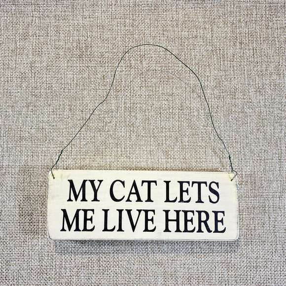Signs-small-My-cat-lets-me-live-here.jpg