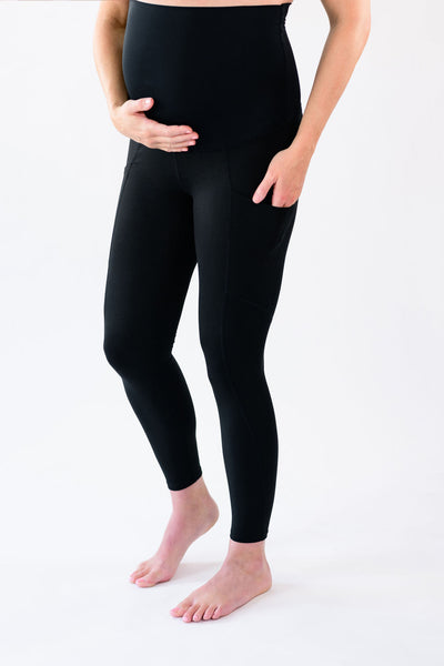 Our over-the-belly maternity leggings with pockets gives bump coverage and extra- support for working out in comfortable stretch fabric in black.