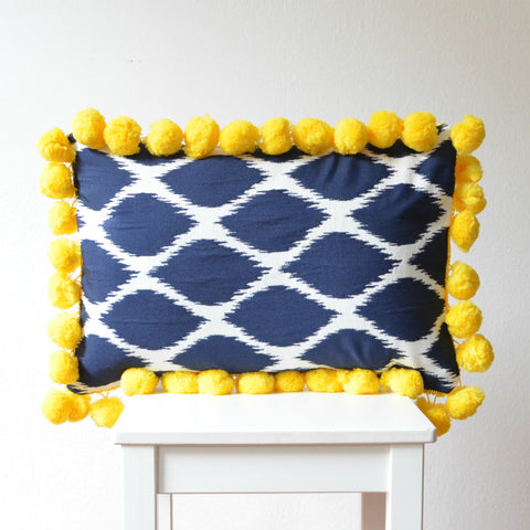 Navy Ikat Pillow with Large Yellow Pompoms