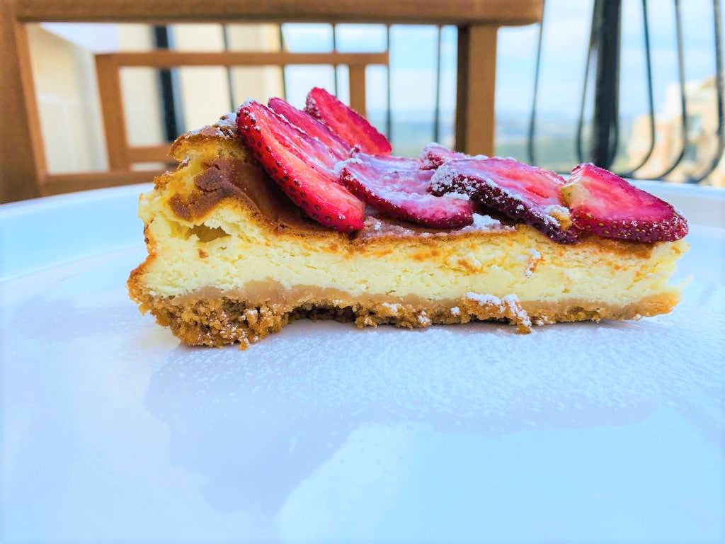 New York Cheese Cake slice with berry couli or chocolate sauce