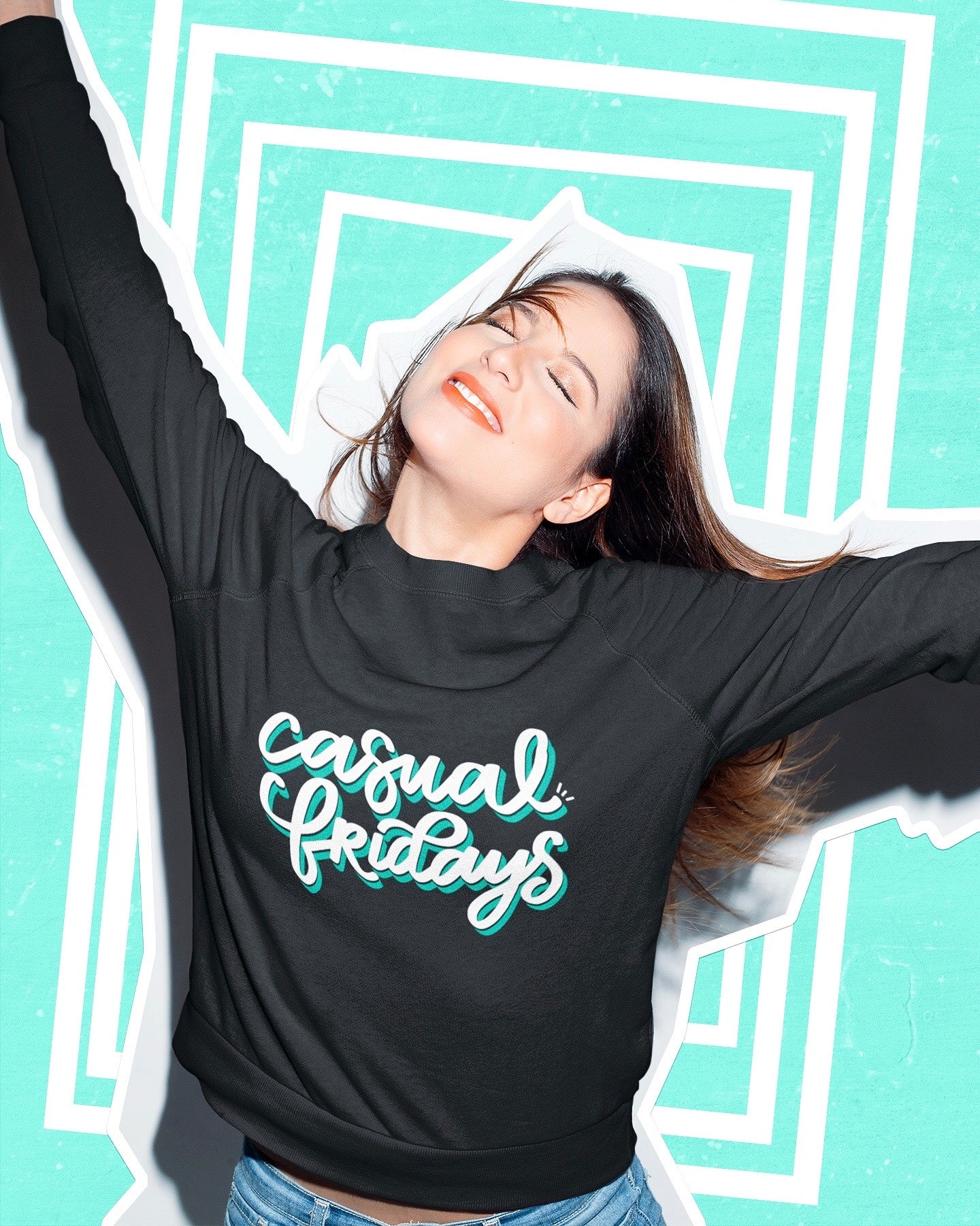 Happy girl wearing a black Casual Fridays sweatshirt on a graphic background | Kerra Sun Creative