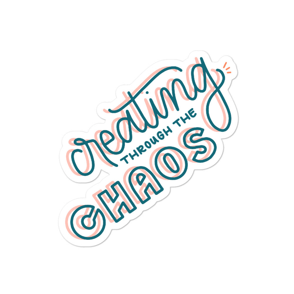 "Sticker that says ""Creating through the chaos"" in hand lettering 