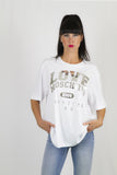 "Love Moschino - T-Shirt bianca con scritta ""Love Moschino 2008 Original Apparel"" in rilievo"