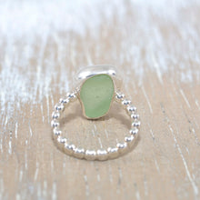 Load image into Gallery viewer, Sea glass ring with soft green sea glass in a fine and sterling silver setting. (R193)