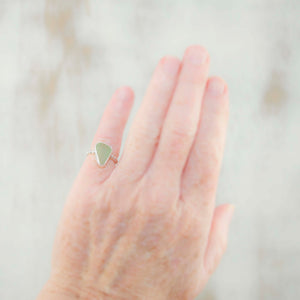 Sea glass ring with soft green sea glass in a fine and sterling silver setting. (R193)