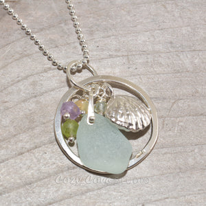 Pendant necklace with sea glass accented with an amethyst, honey onyx, peridot and aquamarine dangle and a shell in sterling silver. (N292)