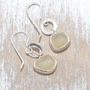 Artisan earrings crafted from yellow sea glass in sterling silver. (E330)