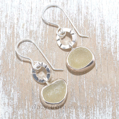 Artisan earrings crafted from yellow sea glass in sterling silver.