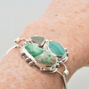 Statement cuff bracelet of Variscite, Malachite and sea glass is a handmade setting of tarnish resistant Argentium ® sterling silver. (B373)