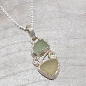 Two piece soft green and yellow sea glass pendant accented with a sparkly peridot in sterling silver. (N386)