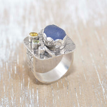 Load image into Gallery viewer, Sea glass statement ring with cornflower blue sea glass accented with sparkly CZs in sterling silver. (R388)