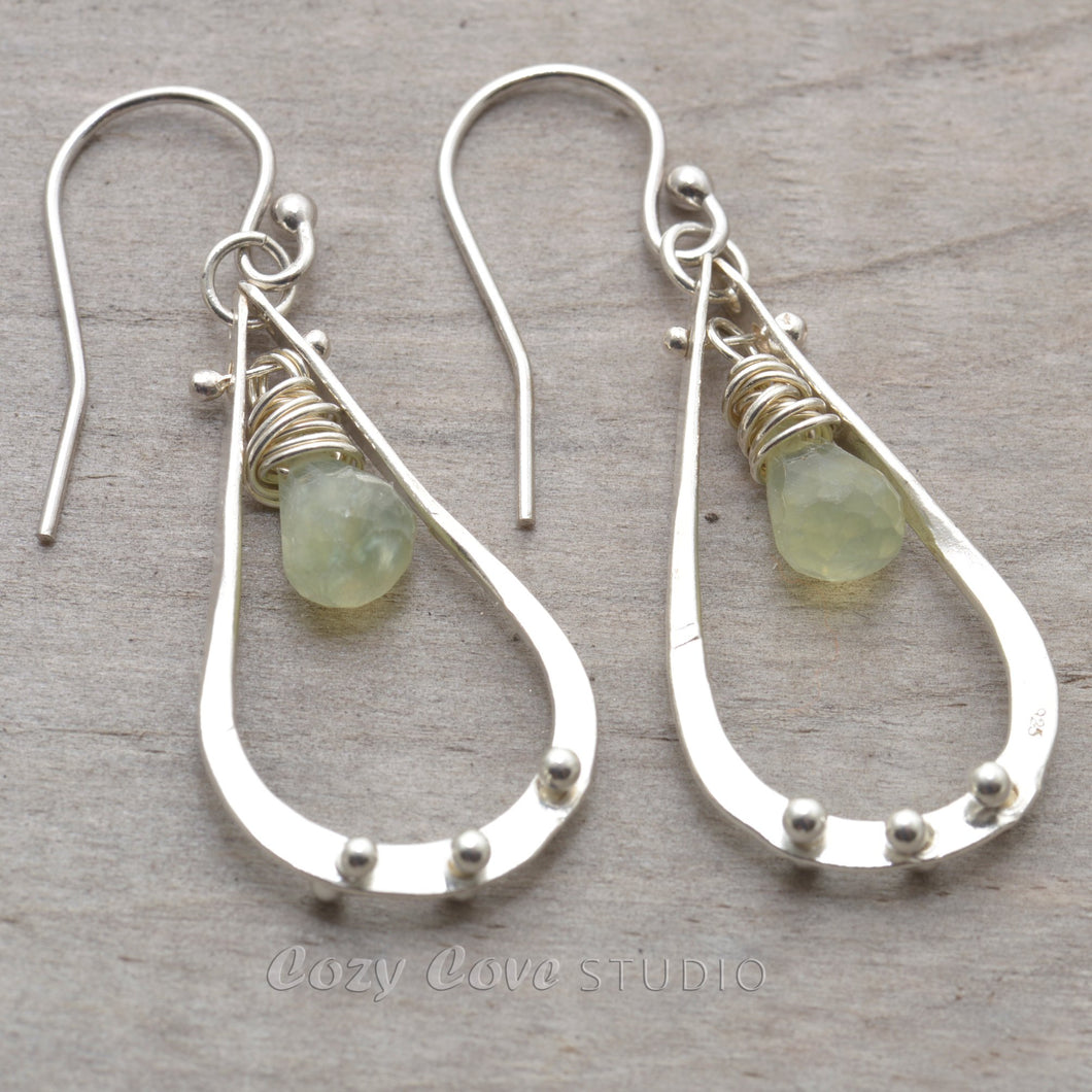 Briolettes of semi-precious soft green prehnite dangle from sterling silver teardrops