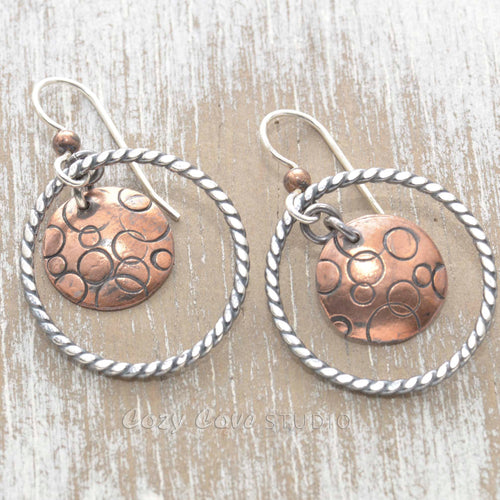 Artisan mixed metals hoop and disk earrings of sterling silver and copper.