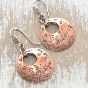 Whimsical handstamped mixed metal earrings of sterling silver and copper.