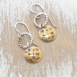 Whimsical handstamped mixed metal earrings of sterling silver and brass.