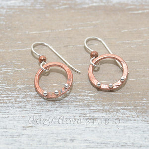 Copper hoop earrings studded with sterling silver