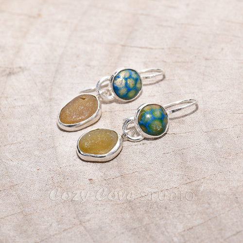 Sea glass and enamel earrings accented with sparkly green CZs in sterling silver settings.