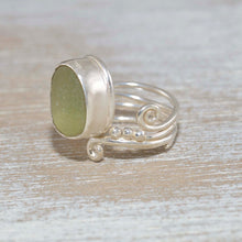 Load image into Gallery viewer, Adjustable sea glass ring with pale lime green sea glass  in a handcrafted setting of sterling silver (R476)